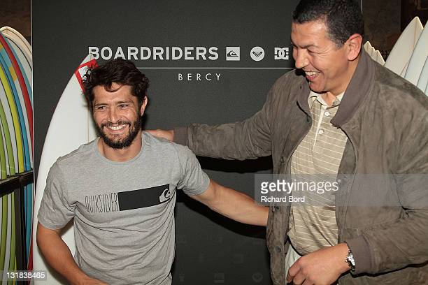 Bixente Lizarazu and French rugby player Abdelatif Benazzi pose during the Quicksikver flagship inauguration at Bercy Village on May 10 2011 in Paris...