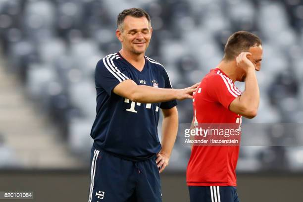 Bixente Lizarazu assistent coach of FC Bayern Muenchen jokes with his player Franck Ribery during a training session at Shenzhen Universiade Sports...