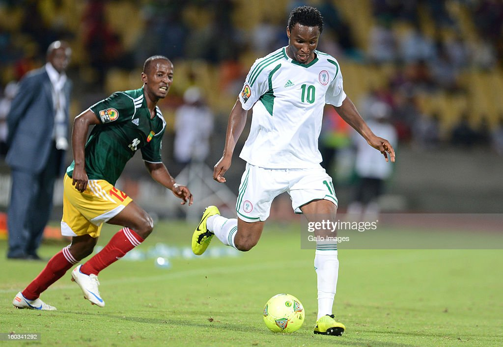 AFRICA - JANUARY 29, Biyadiglign Elyas of Ethiopia and John Obi Mikel of Nigeria during the 2013 African Cup of Nations match between Ethiopia and Nigeria at Royal Bafokeng Stadium on January 29, 2013 in Rustenburg, South Africa.