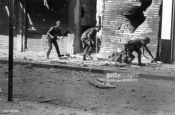 Bizerte War in Tunisia in 1961 Evacuation of a wounded soldier behind the metal shutter of a shop