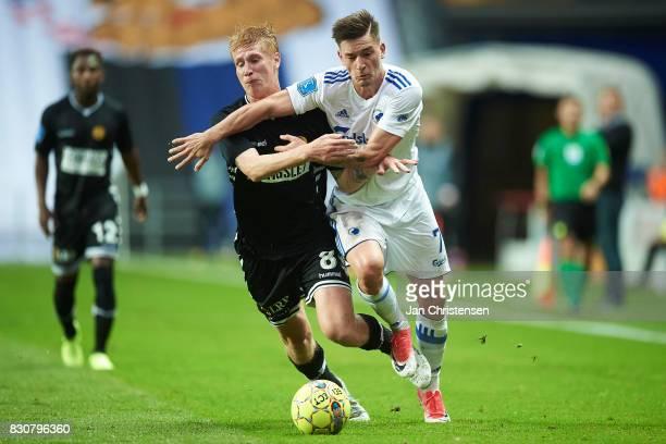 Bjarke Jacobsen of AC Horsens and Benjamin Verbic of FC Copenhagen compete for the ball during the Danish Alka Superliga match between FC Copenhagen...