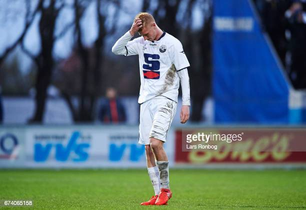 Bjarke Jacobsen of Vendsyssel FF walks off the pitch after receiving a red card from referee Michael Tykgaard during the Danish cup DBU Pokalen...
