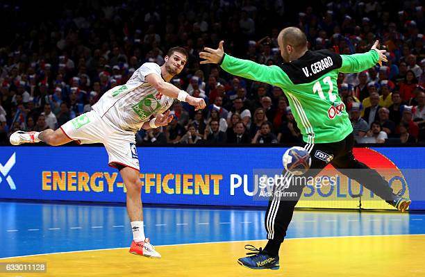 Bjarte Myrhol of Norway shoots past Vincent Gerard of France during the 25th IHF Men's World Championship 2017 Final between France and Norway at...