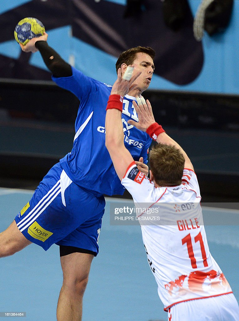 Bjerringbro's Henrik Toft (L) jumps to shoot against Chambery's Guillaume Gille (R) during the Champions League handball match Chambery vs Bjerringbro-Silkenborg on February 10, 2013 in Chambery, eastern France.