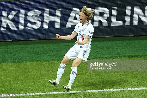 Bjirkir Bjarnason of Iceland celebrates scoring a goal to make the score 11 during the UEFA EURO 2016 Group F match between Portugal and Iceland at...