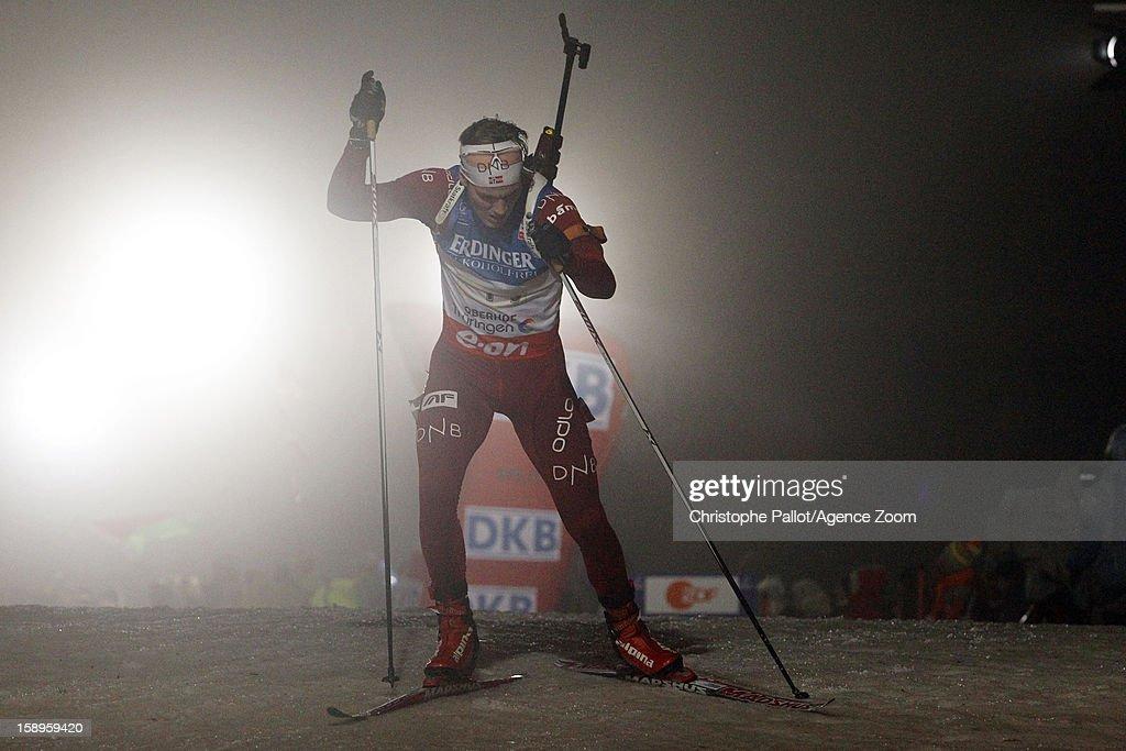 Bjoentegaard Erlend of Norway takes 2nd place during the IBU Biathlon World Cup Men's Relay on January 04, 2013 in Oberhof, Germany.