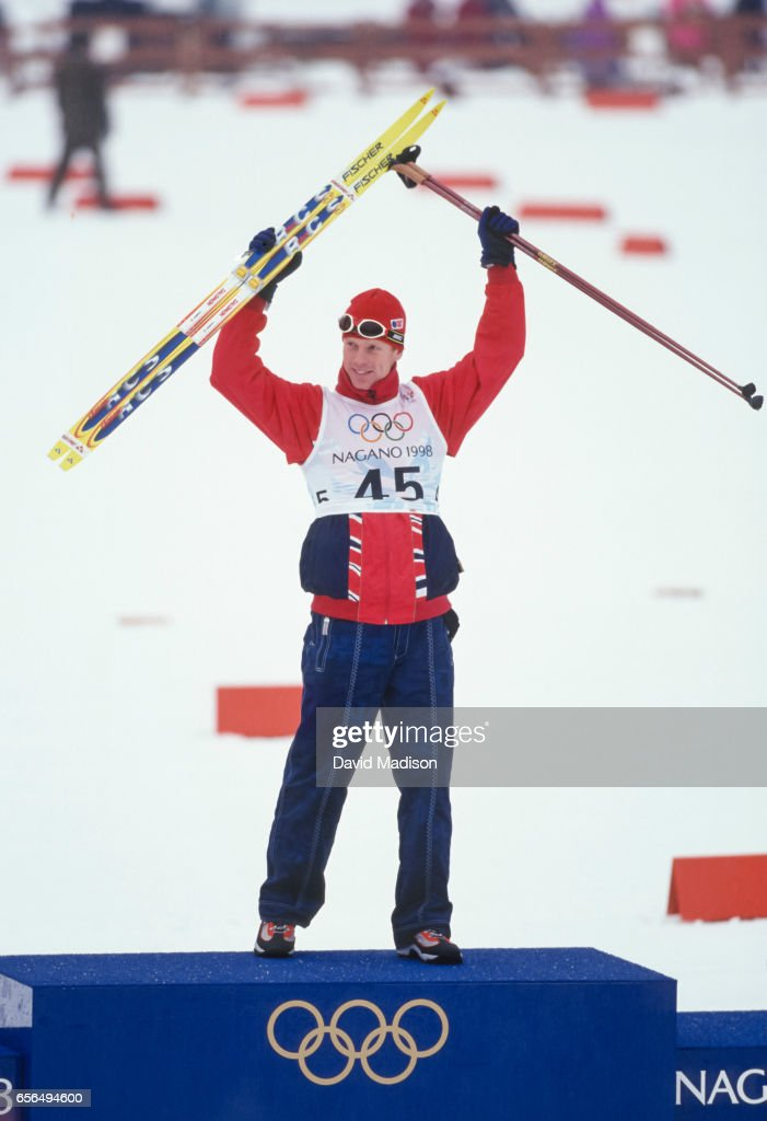 Bjoern Daehlie #45 of Norway celebrates his victory in the Men's 10 Kilometer Classical event of the Nordic Skiing competition at the 1998 Winter Olympics held on February 12, 1998 at the Snow Harp venue in Hakuba near Nagano, Japan.