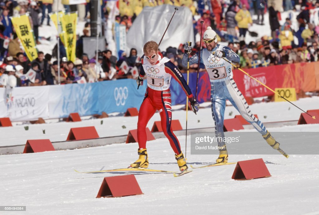 Bjoern Daehlie #1 of Norway skis in the Men's 4 x 10 Kilometer Relay event of the Nordic Skiing competition at the 1998 Winter Olympics held on February 18, 1998 at the Snow Harp venue in Hakuba near Nagano, Japan. Behind Daehlie is Fabio Maj #3 of Italy. Norway won the gold medal in the event; Italy the silver medal.