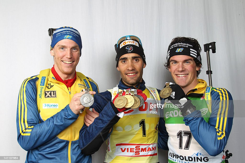 Bjoern Ferry of Sweden, <a gi-track='captionPersonalityLinkClicked' href=/galleries/search?phrase=Martin+Fourcade&family=editorial&specificpeople=5656850 ng-click='$event.stopPropagation()'>Martin Fourcade</a> of France and <a gi-track='captionPersonalityLinkClicked' href=/galleries/search?phrase=Fredrik+Lindstroem&family=editorial&specificpeople=6678382 ng-click='$event.stopPropagation()'>Fredrik Lindstroem</a> of Sweden show their medals of the IBU Biathlon World Championships Men's Mass Start on March 11, 2012 in Ruhpolding, Germany.
