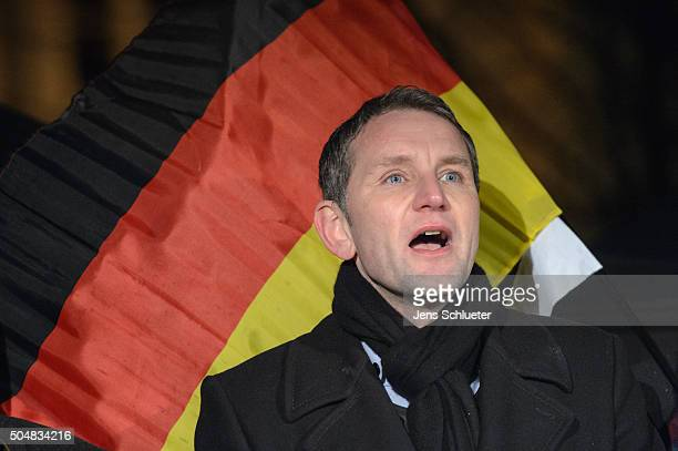 Bjoern Hoecke head of the AfD in Thuringia sings the German national anthem together with supporters at the first AfD Thuringia rally since the...