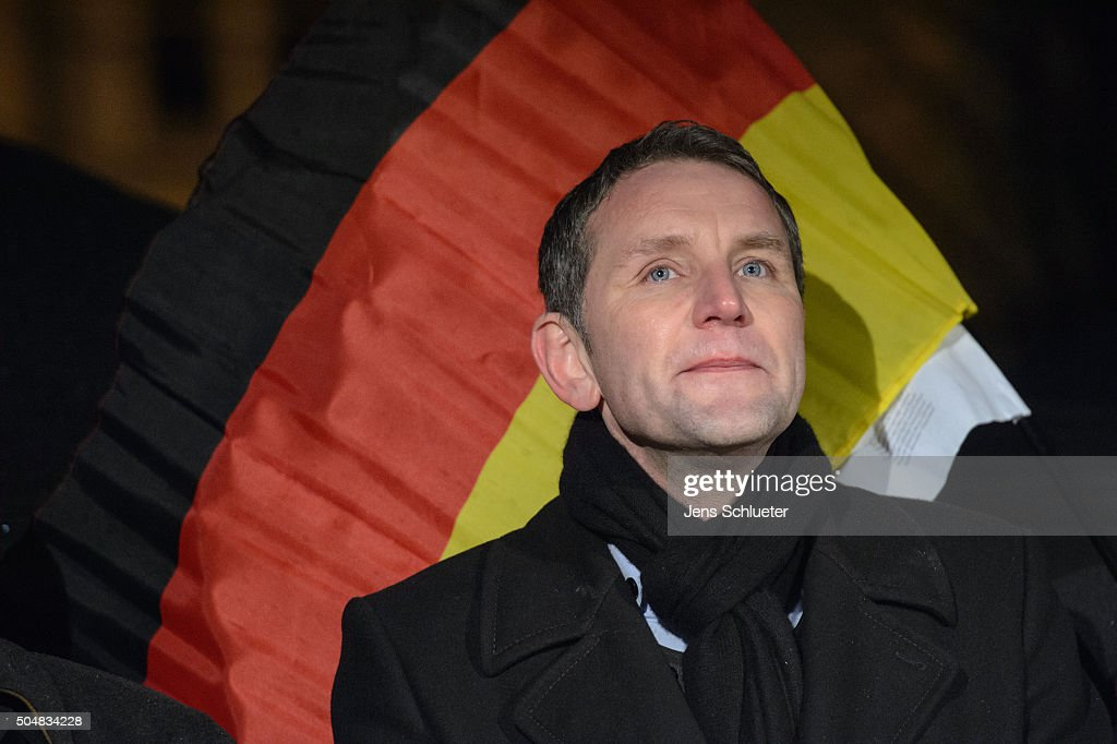 Bjoern Hoecke, head of the AfD (Alternative fuer Deutschland, or Alternative for Germany) in Thuringia, sings the German national anthem together with supporters at the first AfD Thuringia rally since the Cologne sex attacks on January 13, 2016 in Erfurt, Germany. Hoecke, who is on the far-right wing of the AfD, is demanding an immediate closure of Germany's borders to refugees and the expulsion of foreigners with criminal records. Over 500 women have filed charges including molestation, in some cases robbery and even rape following the gathering of hundreds of North African men, many of them were from Morocco and Algeria, at Cologne's Hauptbahnhof main railway station on New Year's Eve. The incident has caused heated discussion in Germany over the government's open-door policy for refugees. In 2015 Germany registered 1.1 million new migrants and refugees.