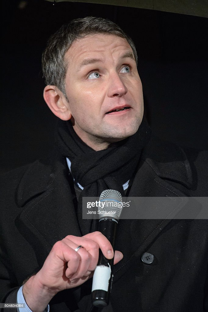 Bjoern Hoecke, head of the AfD (Alternative fuer Deutschland, or Alternative for Germany) in Thuringia, speaks to supporters at the first AfD Thuringia rally since the Cologne sex attacks on January 13, 2016 in Erfurt, Germany. Hoecke, who is on the far-right wing of the AfD, is demanding an immediate closure of Germany's borders to refugees and the expulsion of foreigners with criminal records. Over 500 women have filed charges including molestation, in some cases robbery and even rape following the gathering of hundreds of North African men, many of them were from Morocco and Algeria, at Cologne's Hauptbahnhof main railway station on New Year's Eve. The incident has caused heated discussion in Germany over the government's open-door policy for refugees. In 2015 Germany registered 1.1 million new migrants and refugees.