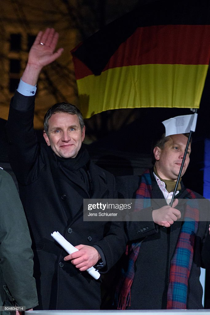 Bjoern Hoecke, head of the AfD (Alternative fuer Deutschland, or Alternative for Germany) in Thuringia, waves to supporters at the first AfD Thuringia rally since the Cologne sex attacks on January 13, 2016 in Erfurt, Germany. Hoecke, who is on the far-right wing of the AfD, is demanding an immediate closure of Germany's borders to refugees and the expulsion of foreigners with criminal records. Over 500 women have filed charges including molestation, in some cases robbery and even rape following the gathering of hundreds of North African men, many of them were from Morocco and Algeria, at Cologne's Hauptbahnhof main railway station on New Year's Eve. The incident has caused heated discussion in Germany over the government's open-door policy for refugees. In 2015 Germany registered 1.1 million new migrants and refugees.