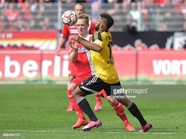 Bjoern Jopek of 1 FC Union Berlin and Phil OfosuAyeh of VfR Aalen during the game between Union Berlin and VfR Aalen on april 12 2015 in Berlin...