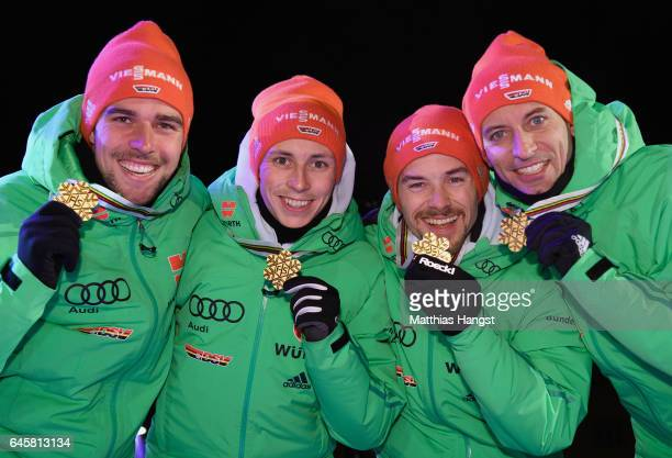 Bjoern Kircheisen Eric Frenzel Fabian Riessle and Johannes Rydzek of Germany pose with their medals during the award ceremony after winning the gold...