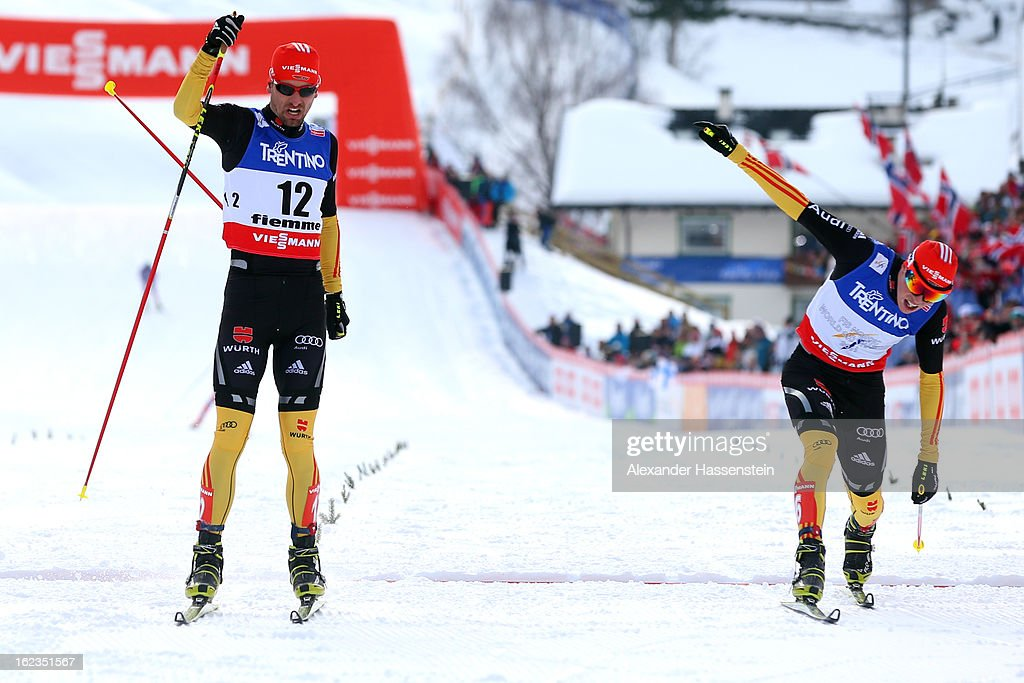 Bjoern Kircheisen (L) of Germany crosses the finish line ahead of his team mate Eric Frenzel during the Men's Nordic Combined on February 22, 2013 in Val di Fiemme, Italy.