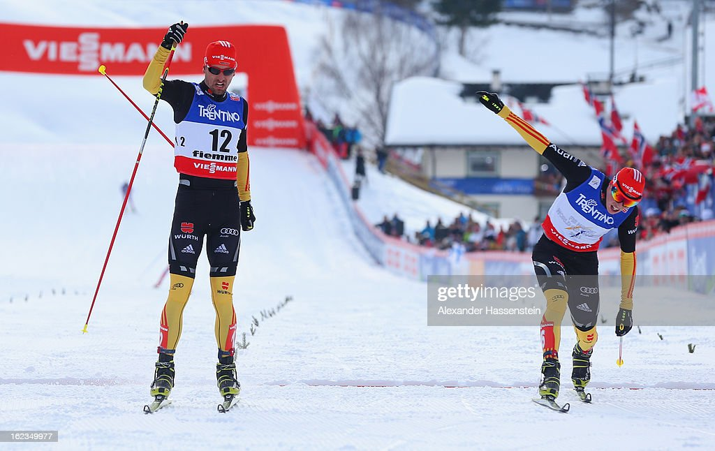 Bjoern Kircheisen (l) of Germany crosses the line in third place ahead of Eric Frenzel of Germany during the Men's Nordic Combined 10km at the FIS Nordic World Ski Championships on February 22, 2013 in Val di Fiemme, Italy.