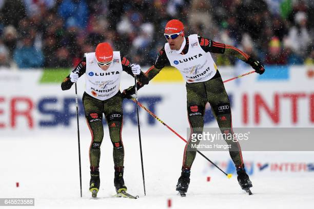 Bjoern Kircheisen of Germany hands over to team mate Eric Frenzel in the Men's Nordic Combined Team HS 100 4 x 50km CrossCountry Sprint during the...