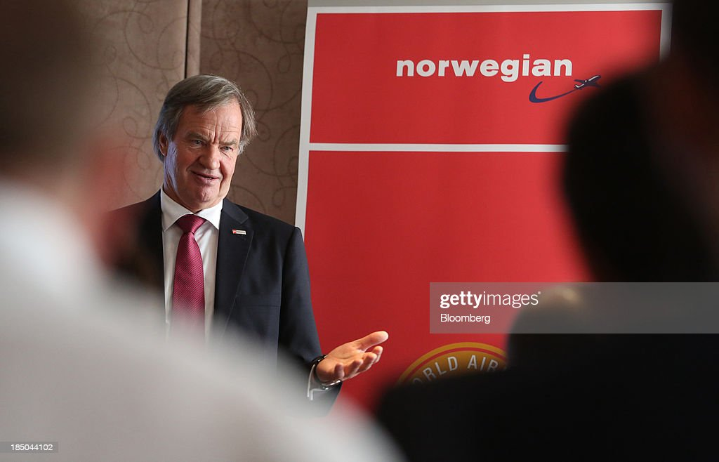 Bjoern Kjos, chief executive officer of Norwegian Air Shuttle AS, gestures as he speaks during a news conference in London, U.K., on Thursday, Oct. 17, 2013. Norwegian Air Shuttle AS will offer flights from London's Gatwick airport to New York, Los Angeles and Fort Lauderdale as it expands a network of discounted long-haul routes using its new fleet of Boeing Co. 787 jetliners. Photographer: Chris Ratcliffe/Bloomberg via Getty Images