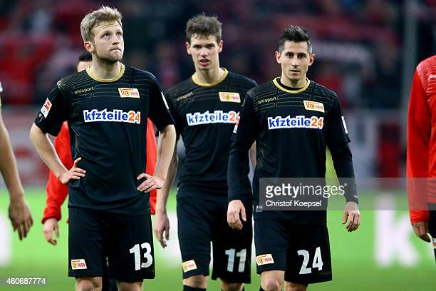 Bjoern Kopplin Maximilian Thiel and Steven Skrzybski of Union Berlin look dejected afrter the Second Bundesliga match between Fortuna Duesseldorf and...