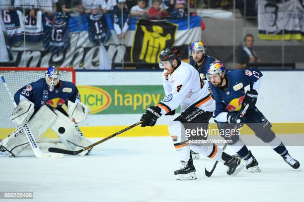 Bjoern Krupp of the Grizzlys competes with Brooks Macek of EHC Muenchen during the DEL PlayOffs Final Match 1 between EHC Muenchen and Grizzlys...
