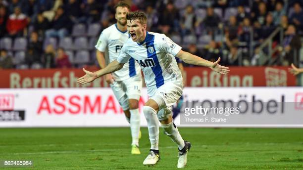 Bjoern Rother of Magdeburg celebrates scoring his teams first goal during the 3 Liga match between VfL Osnabrueck and 1 FC Magdeburg at Stadion an...