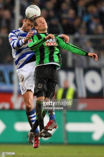 Bjoern Schlicke of Duisburg and Stefan Aigner of Muenchen head the ball during the second Bundesliga match between MSV Duisburg and 1860 Muenchen at...