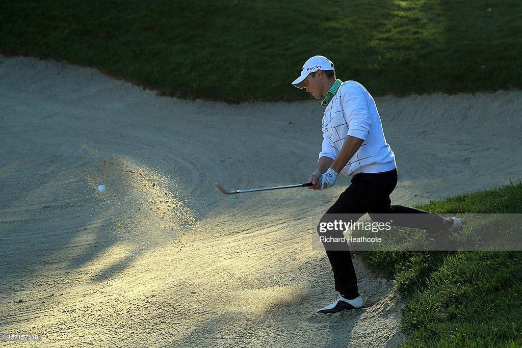 Bjorn Akesson of Sweden plays from a greenside bunker on the 18th during the final round of the European Tour Qualifying School Finals at PGA Catalunya Resort on November 29, 2012 in Girona, Spain.