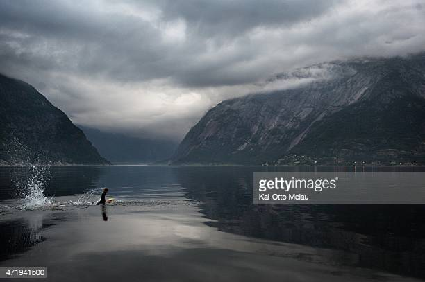 Bjorn Andersson passes the Sima Valley on the swimleg of Norseman Xtreme Triathlon 2012 on August 5 2012 in Norway The race which was first held in...