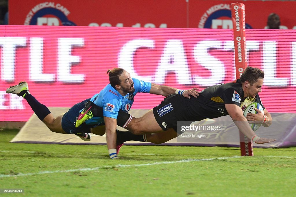 Bjorn Basson of the Bulls can't stop Rohan Janse van Rensburg of the Lions from scoring during the Super Rugby match between the Vodacom Bulls and Emirates Lions at Lotus Versfeld Stadium on May 28, 2016 in Pretoria, South Africa.