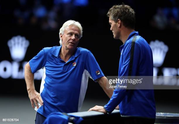 Bjorn Borg and Thomas Enqvist of Team Europe chat after the singles match between Dominic Thiem of Team Europe and John Isner of Team World on the...