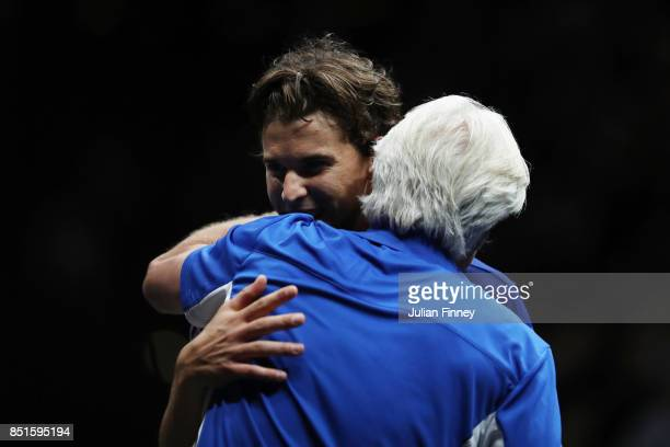 Bjorn Borg Captain of Team Europe and Dominic Thiem of Team Europe celebrate after winning match point his singles match against John Isner of Team...