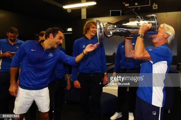 Bjorn Borg Captain of Team Europe and Roger Federer of Team Europe drink champagne from Laver Cup trophy after winning the Laver Cup on the final day...