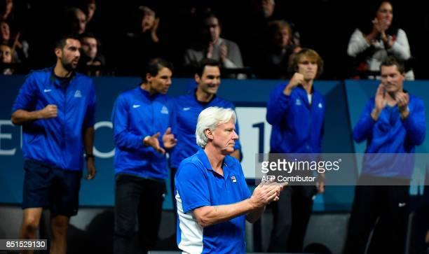 Bjorn Borg Captain of Team Europe applauds during the match John Isner against Austrian Dominic Thiem of Team Europe during the first day of the...