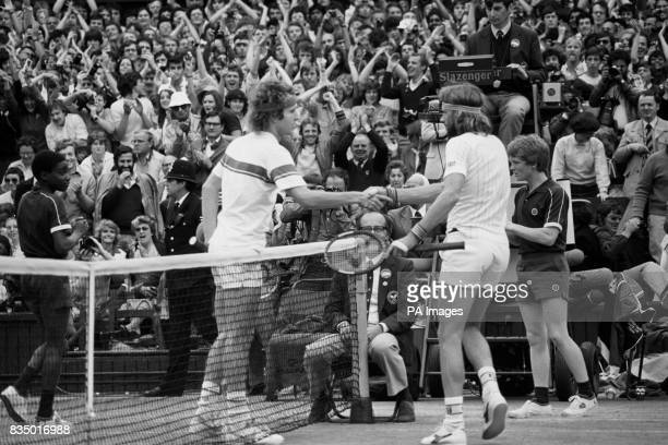 Bjorn Borg congratulates the new champion John McEnroe with the traditional handshake at the nets after the final on Centre Court McEnroe won 46 76...