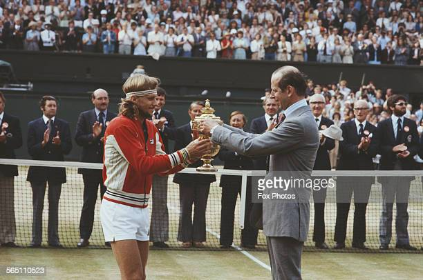 Bjorn Borg of the Sweden receives the trophy from the Duke of Kent after defeating Roscoe Tanner during the Men's Singles Final match at the...