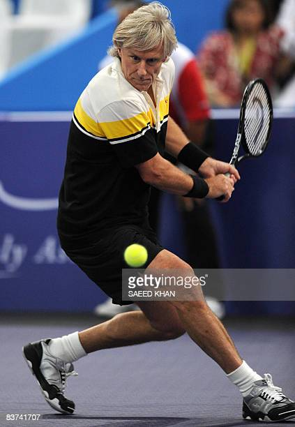 Bjorn Borg plays a shot against John McEnroe of USA during an exhibition match in Kuala Lumpur on November 18 2008 John McEnroe won the battle of the...