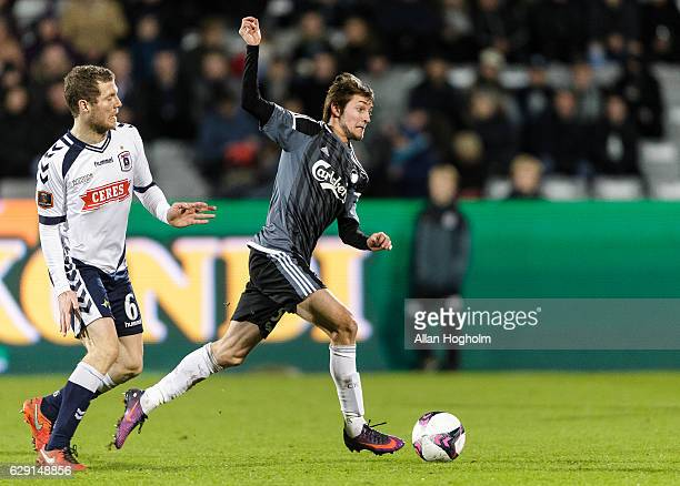 Bjorn Daniel Sverrisson of AGF and Rasmus Falk of FC Copenhagen compete for the ball during the Danish Alka Superliga match between AGF Aarhus and FC...