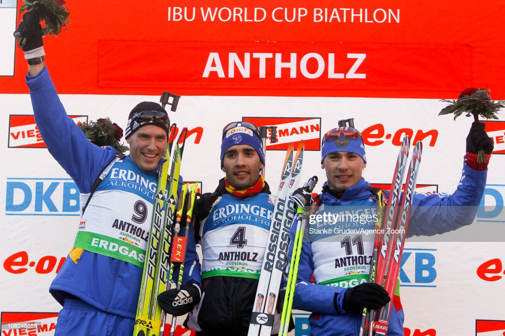 Bjorn Ferry of Sweden takes 2th place,Martin Fourcade of France takes 1st place, Anton Shipulin of Russia takes 3rd place during the IBU World Cup Biathlon Men's 15 km Mass Start on January 22, 2011 in Antholz-Anterselva, Italy.