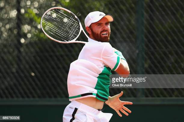 Bjorn Fratangelo of The United States plays a backhand during the mens singles first round match against Feliciano Lopez of Spain on day two of the...