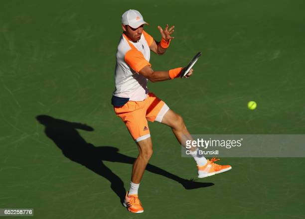 Bjorn Fratangelo of the United States plays a forehand against Tomas Berdych of the Czech Republic in their second round match during day six of the...