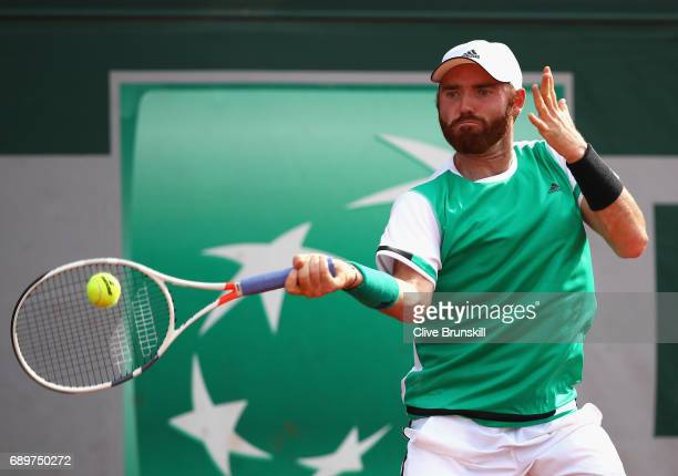 Bjorn Fratangelo of The United States plays a forehand during the mens singles first round match against Feliciano Lopez of Spain on day two of the...
