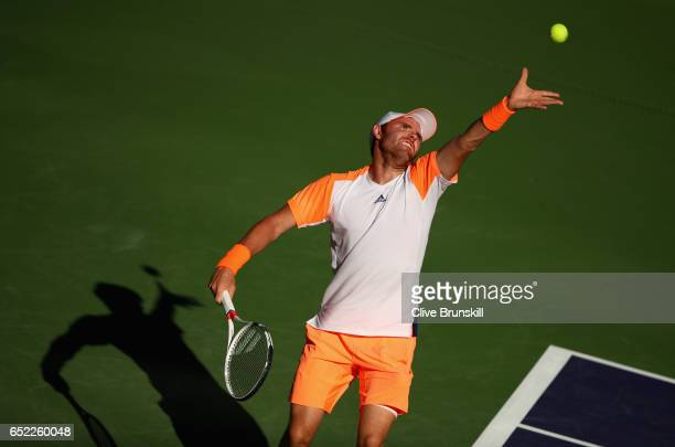 Bjorn Fratangelo of the United States serves against Tomas Berdych of the Czech Republic in their second round match during day six of the BNP...
