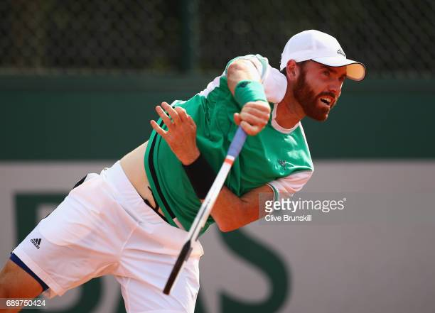 Bjorn Fratangelo of The United States serves during the mens singles first round match against Feliciano Lopez of Spain on day two of the 2017 French...