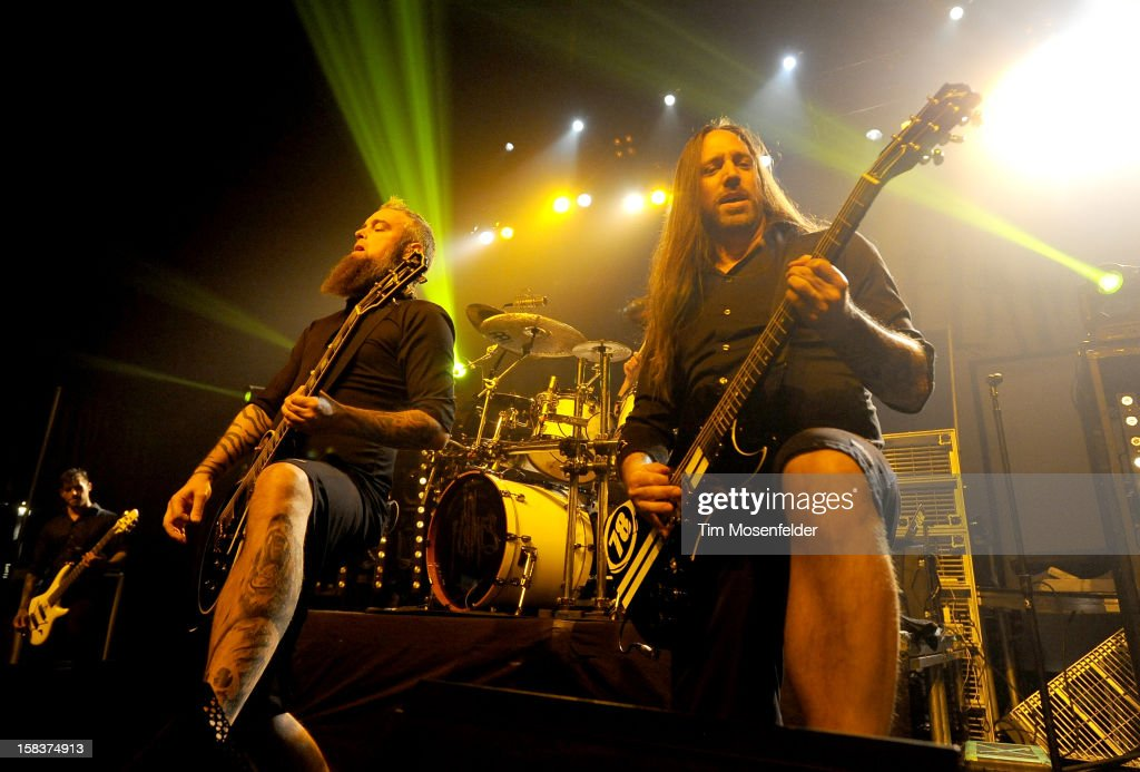 Bjorn Gelotte (L) and Niclas Engelin of In Flames perform in support of the bands' 'Sounds of a Playground Fading' release at The Warfield on December 13, 2012 in San Francisco, California.