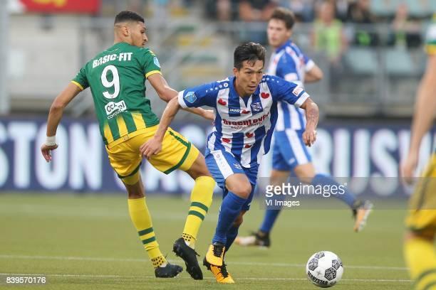 Bjorn Johnsen of ADO Den Haag Yuki Kobayashi of sc Heerenveen during the Dutch Eredivisie match between ADO Den Haag and sc Heerenveen at Kyocera...
