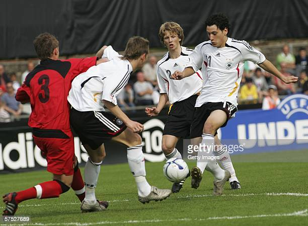 Bjorn Kopplin and Timo Gebhart of Germany and Toby Alderweireld of Belgium battle for the ball during the Men's Under 17 European Championship match...