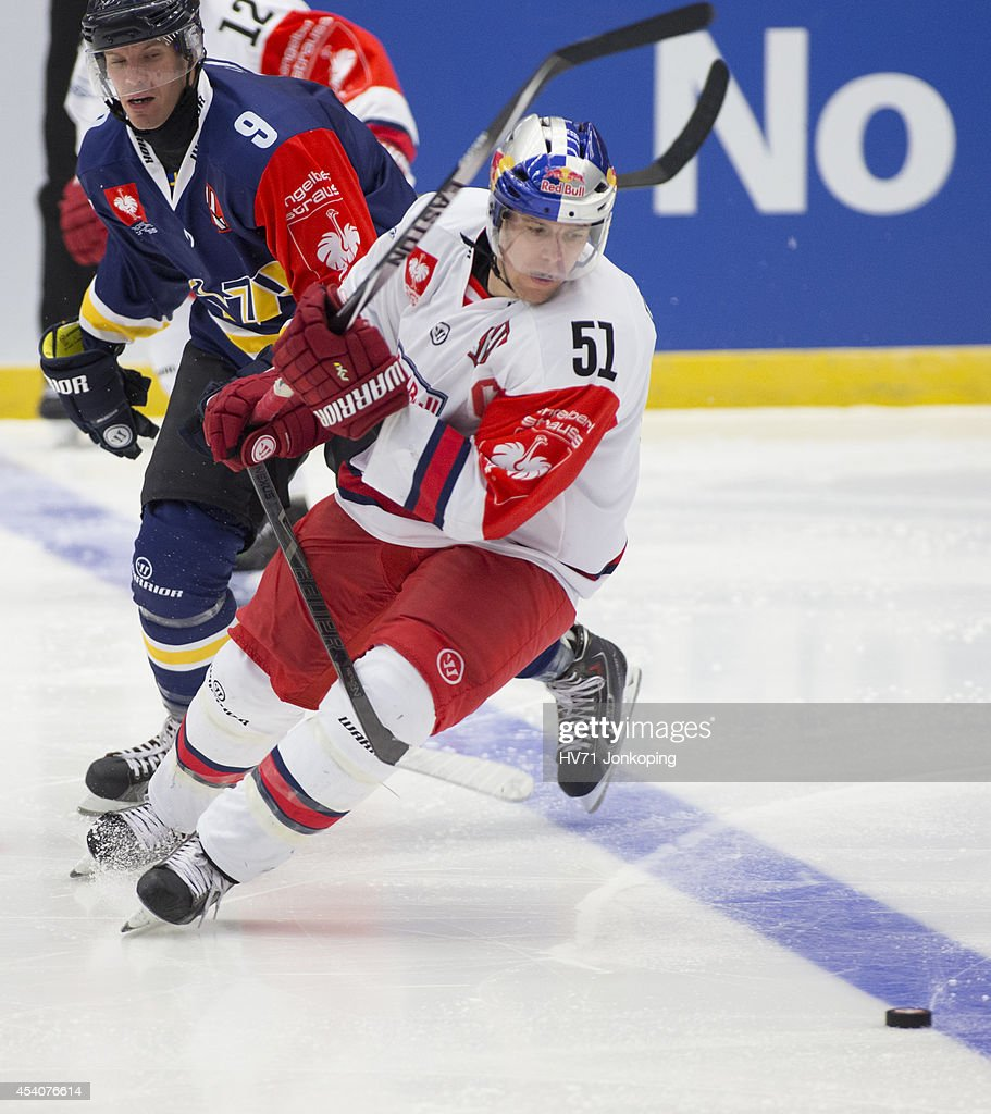 <a gi-track='captionPersonalityLinkClicked' href=/galleries/search?phrase=Bjorn+Melin&family=editorial&specificpeople=640939 ng-click='$event.stopPropagation()'>Bjorn Melin</a> #9 of HV71 and <a gi-track='captionPersonalityLinkClicked' href=/galleries/search?phrase=Matthias+Trattnig&family=editorial&specificpeople=2455037 ng-click='$event.stopPropagation()'>Matthias Trattnig</a> #51 of Red Bull Salzburg in action during the Champions Hockey League group stage game between HV71 Jonkoping and Red Bull Salzburg on August 24, 2014 in Jonkoping, Sweden.