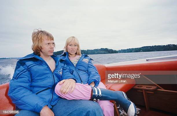 Bjorn Ulvaeus and Agnetha Faltskog his wife sitting in the back of a boat