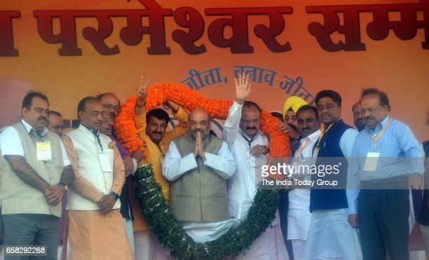 BJPs President Amit Shah with Manoj Tiwari and Venkaiah Naidu during Karyakarta Sammelan in New Delhi